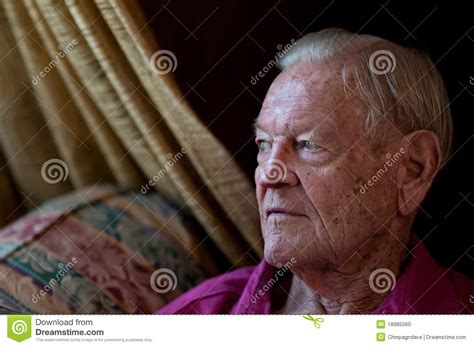 in home sitting elderly sitting by window in home stock photo image 18985060