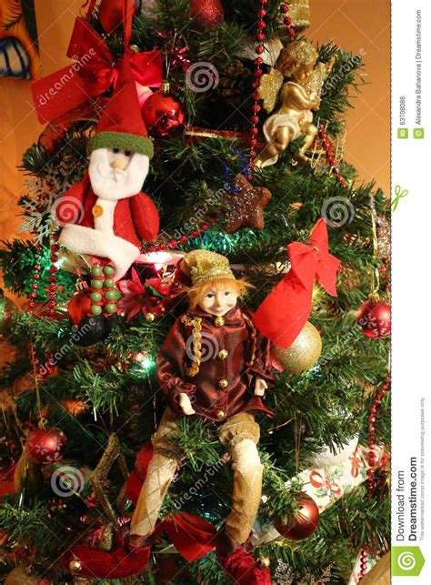elves lightingand decorating charlotte tree santa lights and tree decorations stock photo image of balls