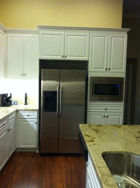 gap between fridge and cabinets please please help me how to decorate fill the gap on