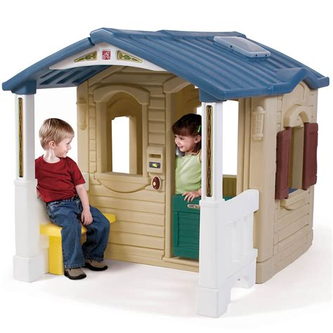 kids play houses naturally playful front porch playhouse kids playhouse step2