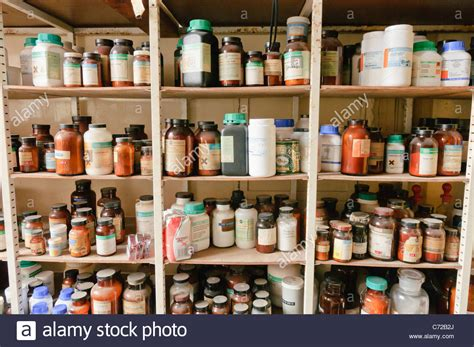 on the shelves chemicals on the shelves of a school chemistry laboratory