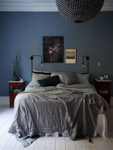 bedroom design and fitting bedroom blue walls grey bedspread black spherical light