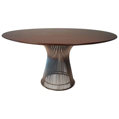 warren platner dining table in walnut with nickel
