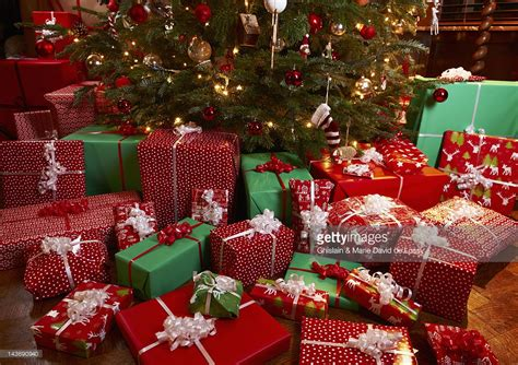 christmas gifts under tree stock photo getty images