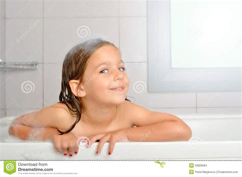 Girl in a bathtub stock photo. Image of clean, house