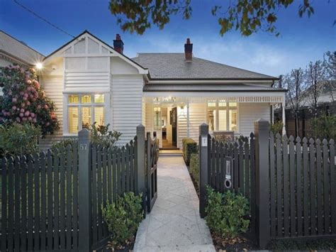 white weatherboard house weatherboard home painted in white with grey slate and
