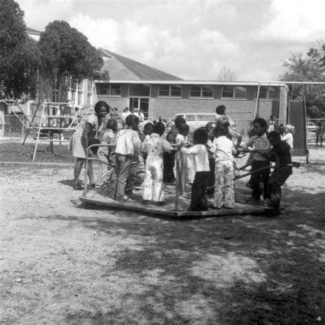 boarding tallahassee florida memory day care center children on playground at lincoln high school