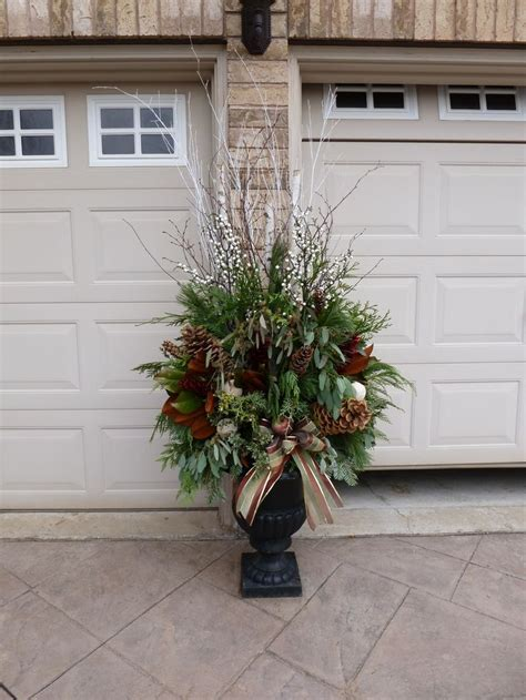christmas decorating huge stone urns in front of entrance 25 best ideas about outdoor planters on planters
