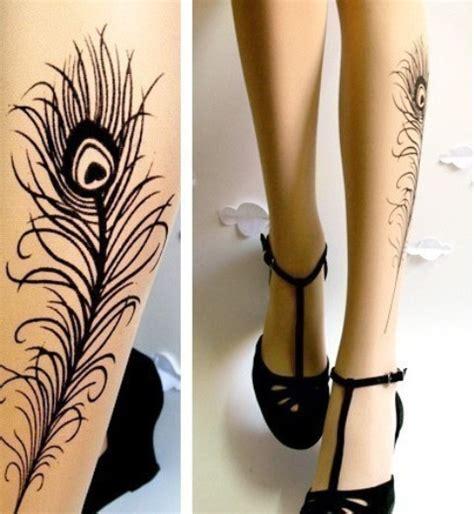 tattoo feather leg tattoo designs peacock feather tattoo on leg