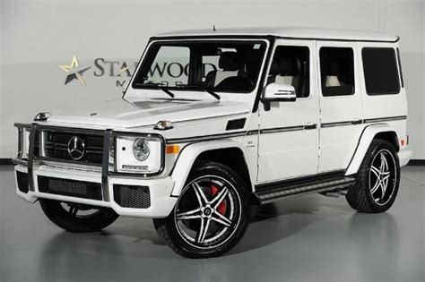 mercedes land rover white range rover hse vs mercedes g63 amg