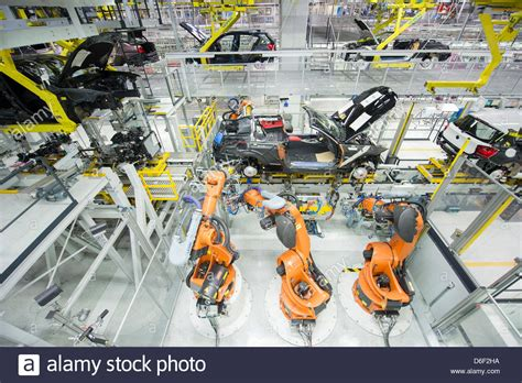 bmw factory robots several robots work on a car at a factory of car