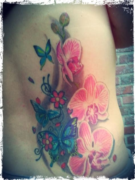 butterfly cover up tattoos orchidee and butterfly cover up tattoos