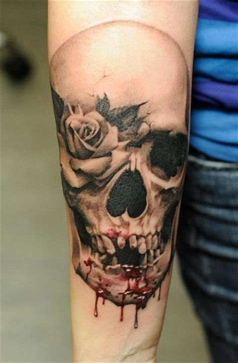 arm flower skull blood tattoo by radical ink