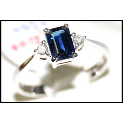 emerald cut blue sapphire and 18k white gold ring