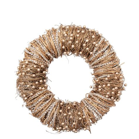 gold beaded wreath by the christmas home