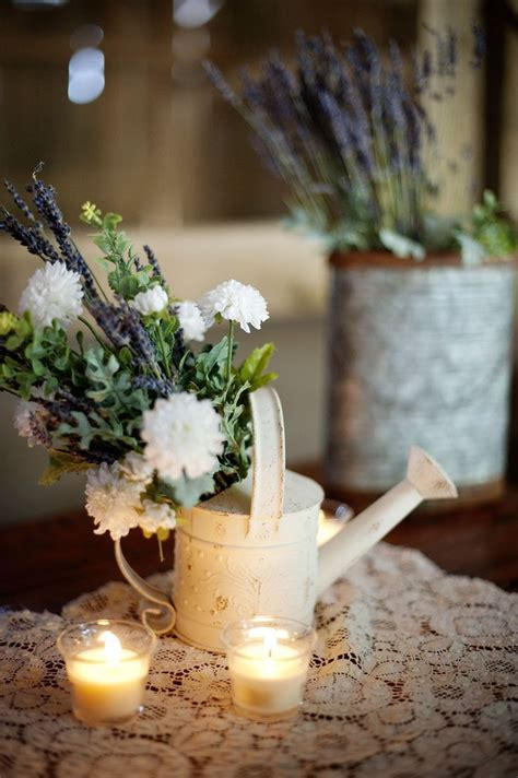 watering can centerpieces 25 best ideas about watering can centerpieces on burlap wedding decorations rustic