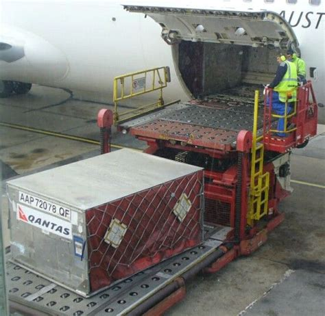 qantas cargo aap container  loaded   airport