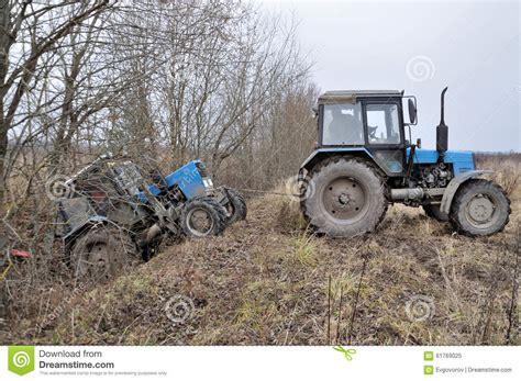 stuck ziehen tractor towing stuck tractor stock photo image 61769025