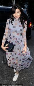Dotty Carol Maxi lowe is covered up as she sports retro maxi dress at