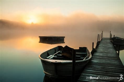 buy calm misty lake  pier  boats boat close