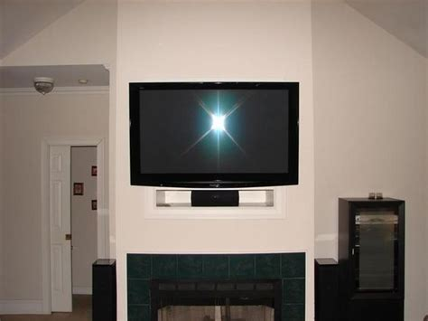 how to eliminate the quot tv niche quot above the fireplace home