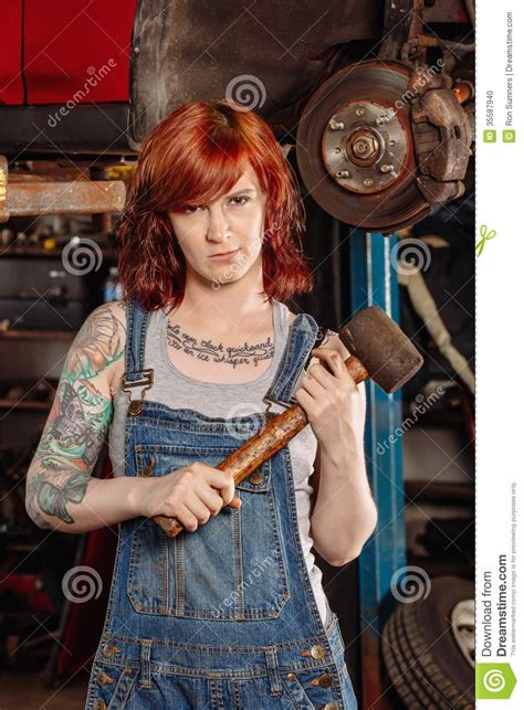 female mechanic holding rubber mallet stock photo image