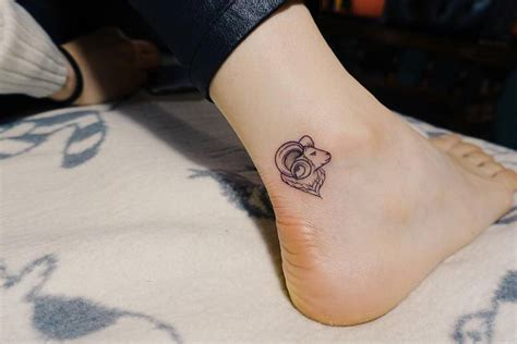 small ram tattoo on the right ankle