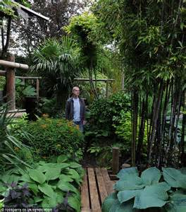 creates paradise garden with banana plants and