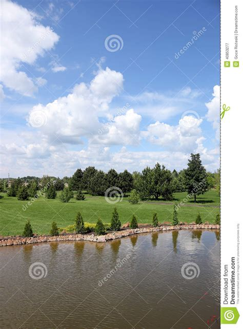 pond and blue sky landscape stock photo image 40853277