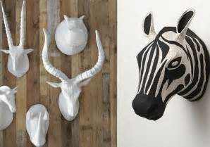 Paper mache animal heads from west elm left and anthropologie right