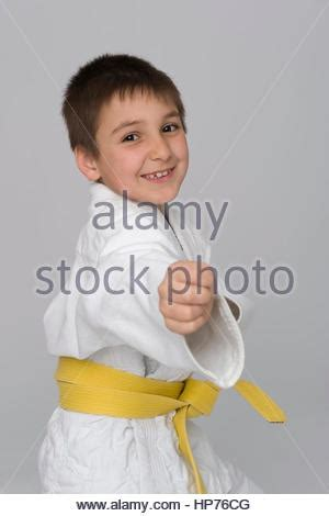 eight year old boy makes faces to the camera stock photo