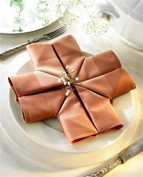 Table Napkin Origami - napkin fold creating a creative table decorations for