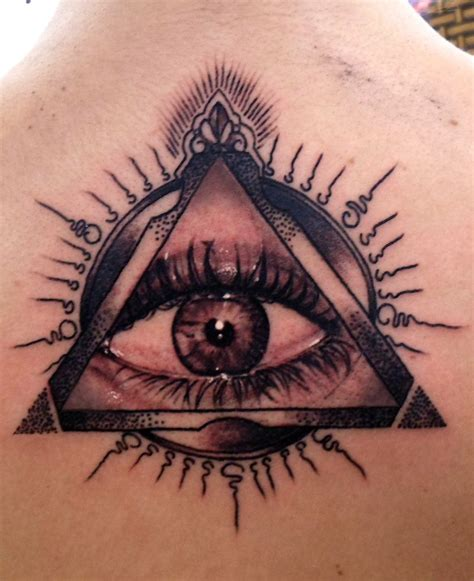 tattoo eyes black ink illuminati eye on back tattoos