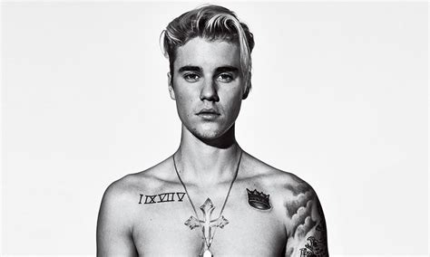 justin bieber gq tattoo video justin bieber gives the story behind his tattoos