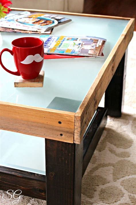 Diy upcycled coffee table made with pallet boards and a piece of frosted glass very cool