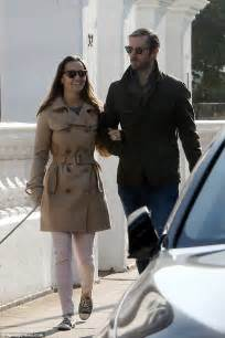 Kate s sister dressed down for the outing in a camel coloured mac