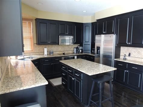 u shaped small kitchen designs with black cabinet and