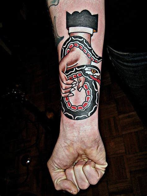 hand holding cross tattoo 70 traditional snake designs for slick ink ideas