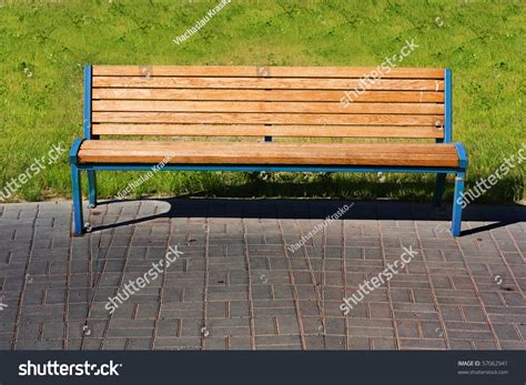 bench over wooden bench over green grass stock photo 57062941