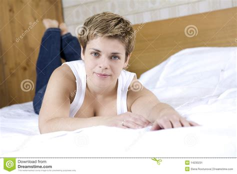 lying on bed woman with long hair lying on bed stock image image