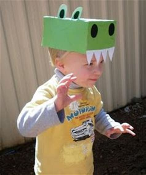 How To Make A Dinosaur Hat Out Of Paper - home made made dinosaur dino sock puppets 9
