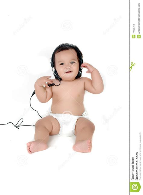 tiny chubby girls a chubby little girl listen to music stock photography