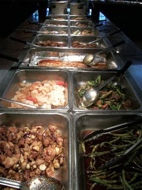 various entees side dishes baked fish in center
