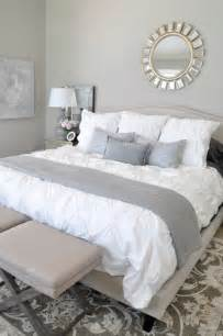 neutral master bedroom white bedding with neutral rug