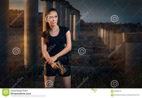 film action girl terbaik powerful woman holding gun action movie style stock photo