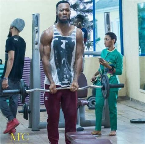 biography of nigerian artist phyno flavour shows off his muscles as he works out with