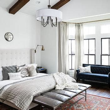 bay window sofa bed white wingback bed with blue curtains transitional bedroom