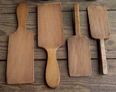 antique wooden butter spades hands  paddles