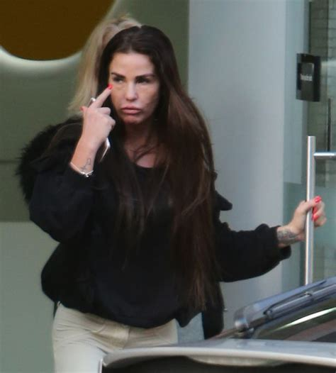 Make up free Katie Price looks downcast as she makes a