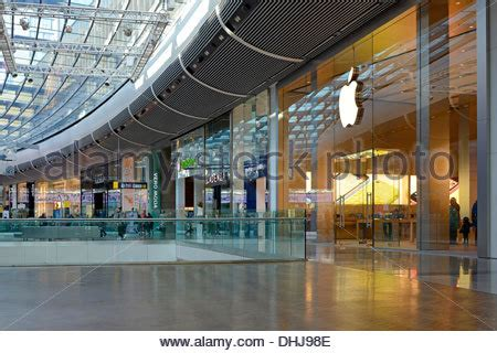 apple store canberra centre apple store shopfront in shopping mall with large laptop in window stock photo royalty free
